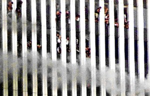 Colour photograph showing people trapped at the top of one of the WTC Towers. This Tower collapsed soon afterwards.