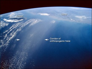 Colour photograph showing a coherent corridor of anthropogenic (man-made) haze, approximately 200 Km wide, over the East China Sea. This photograph was taken from the U.S. Space Shuttle, on 4th March 1996.