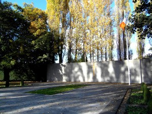 Colour photograph showing the last resting place, in Arbour Hill Cemetery Dublin, for many - not all - Executed Leaders of the 1916 Revolution. The Memorial was designed by G. McNicholl. Photograph taken by CJ Walsh. 2010-10-24. Click to enlarge.