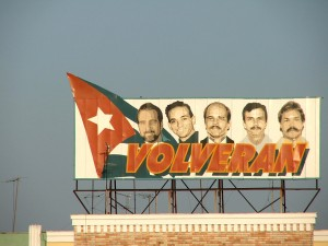 Colour photograph showing a Miami Five Freedom Campaign Hoarding on the top of a building in Cienfuegos, Cuba. Photograph by CJ Walsh. 2007-04-14. Click to enlarge.