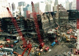 Colour photograph showing advanced clean up operations at the World Trade Center Complex after 11 September 2001. Fires continued to smoulder for weeks after the Incident. Click to enlarge.