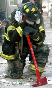 Colour photograph showing a Firefighter on the day after 9-11 (2001). Photograph by Matthew McDermott / Corbis Sygma.