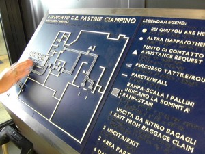 Colour photograph showing a good example of a Braille Map, having strong colour contrast and with texts in Italian and English, at the Arrivals Building Main Entrance/Exit in Rome's Ciampino Airport. Photograph by CJ Walsh. 2011-10-26. Click to enlarge.