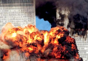 Colour photograph showing the two World Trade Center Towers immediately after the impact of the second plane. At a fundamental level, this was a 'real' extreme fire event ... which was extensively investigated by the U.S. National Institute of Standards & Technology (NIST) ... and resulted in the important 2005 & 2008 NIST WTC Recommendations. Click to enlarge.