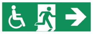 Colour image showing an Accessible Fire Evacuation Route Sign. From now on, Building Users should expect that these routes will be Accessible-for-All, throughout their full extent, until they reach a Place of Safety which is remote from the Building. Otherwise, they will be able to find accommodation in a suitable Area of Rescue Assistance along the route. Click to enlarge.