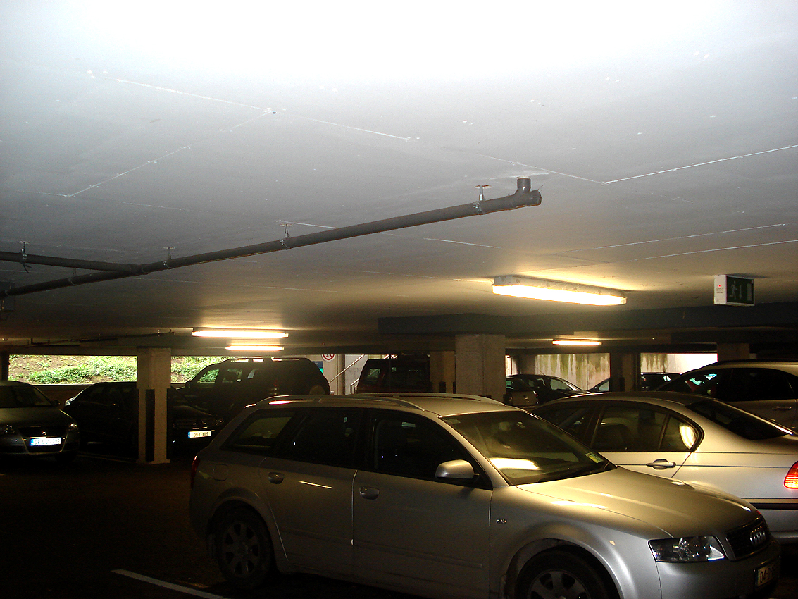 Colour photograph showing the basement car park in a hospital. Click