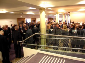 "Colour photograph showing Delegates at the 2012 IIEA/TEPSA Irish EU Presidency Conference in Dublin - described by one journalist as ""a heavyweight audience of policymakers and 'leading thinkers' "" - chatting over morning coffee and tea. Notice the lethal-looking metal handrail extensions in the foreground. Photograph taken by CJ Walsh. 2012-11-23. Click to enlarge."