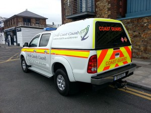 Irish Coast Guard Vehicle, with High Visibility Markings, at Howth Harbour in Dublin.
